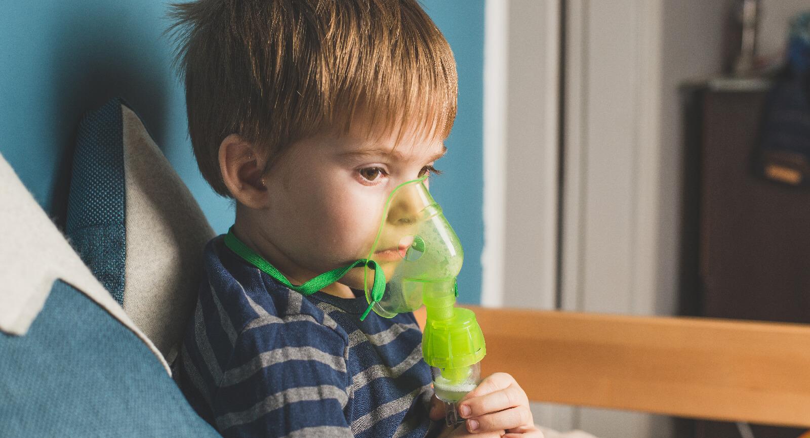 Boy with nebulizer for hypertonic saline